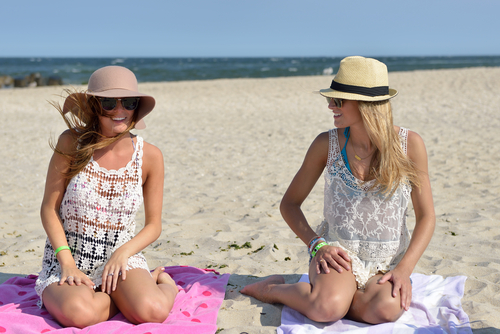 Two friends with covered bathing suits.