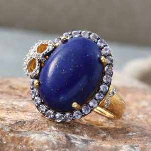 Lapis lazuli halo statement ring in sterling silver with 14K yellow gold finish.