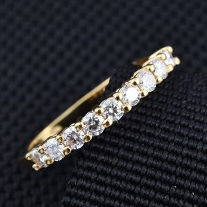 Moissanite line ring in sterling silver with 14K yellow gold finish.