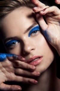 Woman with dramatic blue eye makeup.