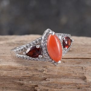 Meriterranean coral ring with pyrope accents in sterling silver with platinum finish.