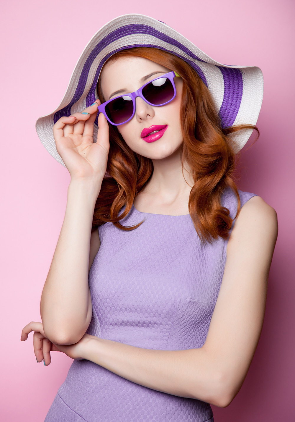 Girl wearing purple hat, purple sunglasses and purple dress
