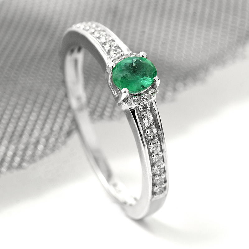 Closeup of Brazilian emerald ring, showing stone detail.