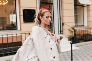 woman wearing draped trench coat