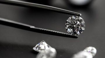 Closeup of diamond held by tweezers