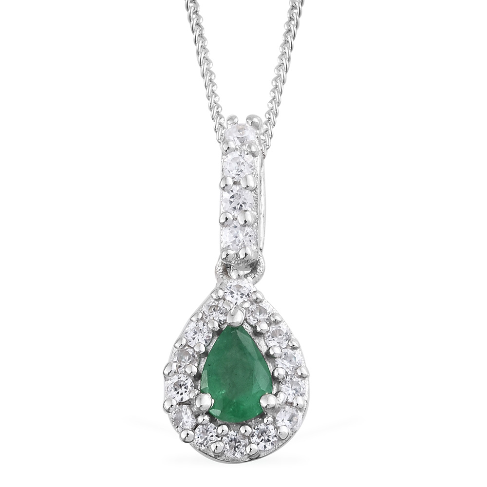 Closeup of emerald necklace against white background