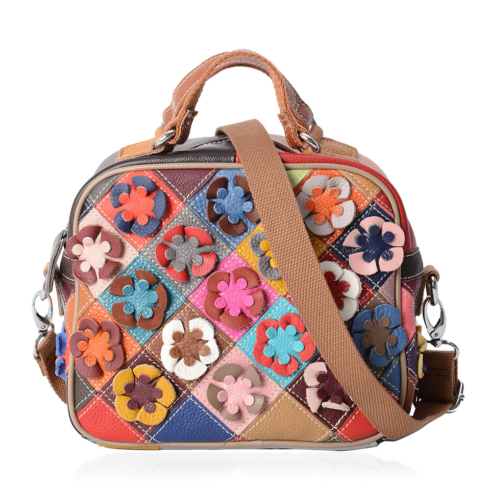 Cute floral handbag against white background.
