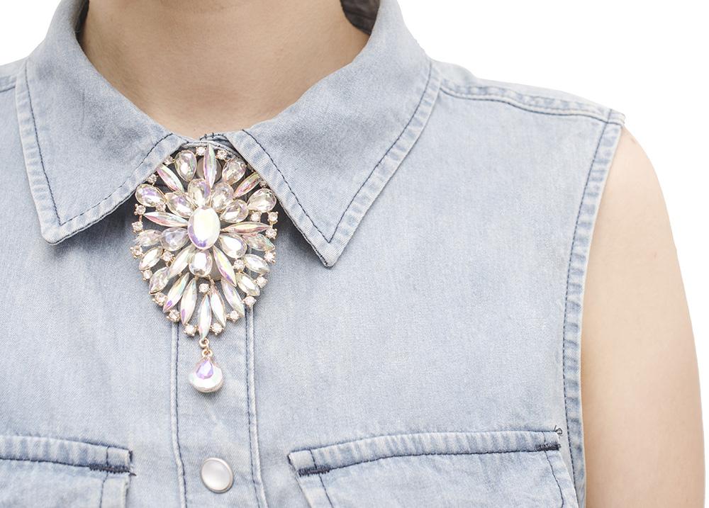 Closeup of faux necklace on denim top
