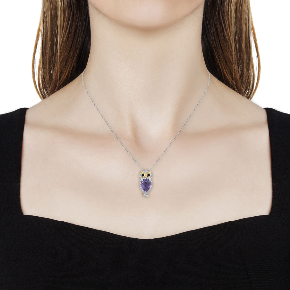 Closeup of owl pendant necklace