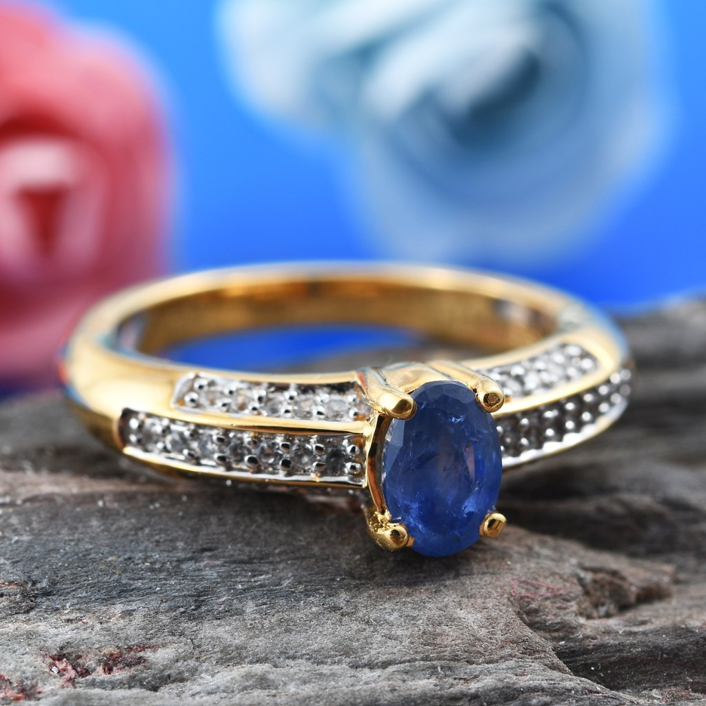 Burmese Sapphire ring in yellow gold on stone base.