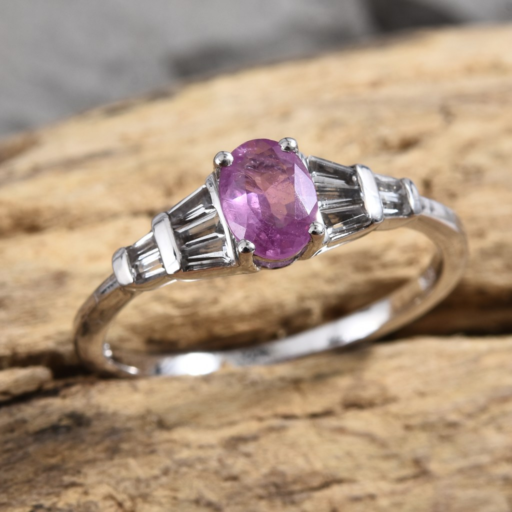 Ilakaka Hot Pink Sapphire ring on wooden base.