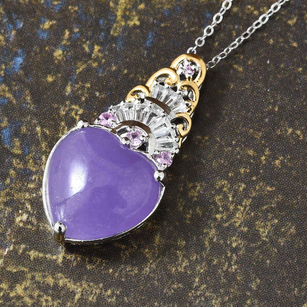Closeup of purple jade necklace against dark brown background