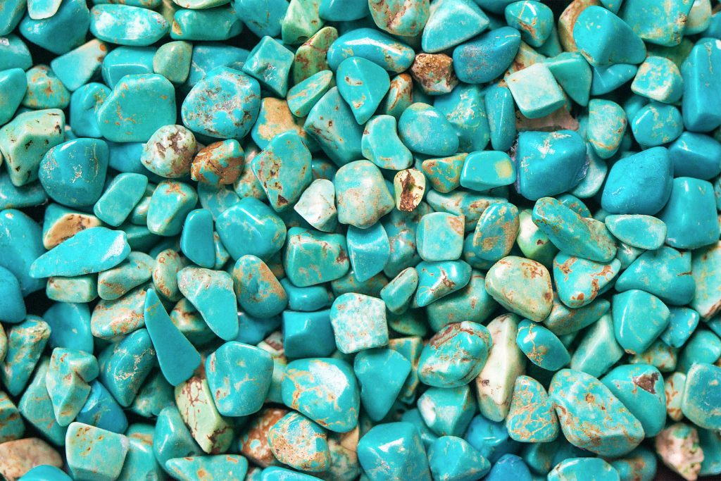 Selection of tumbled turquoise gemstones.