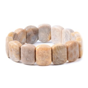Beige coral stretch bracelet on white background.