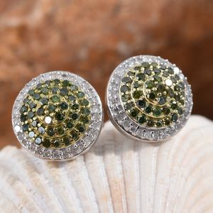 Green diamond earrings displayed on shell.