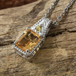 Citrine pendant against wooden backdrop.