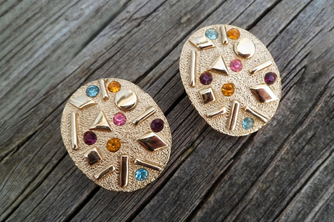 1960s clip-on earrings featuring colored crystals and geometric designs.