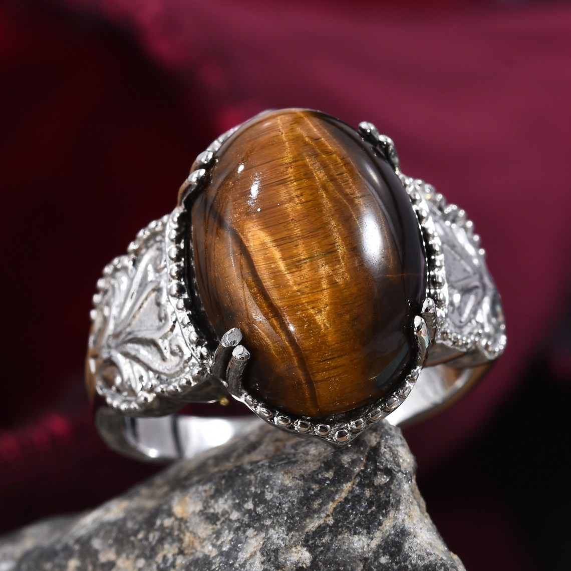 Silver ring featuring prominent tiger's eye gemstone.