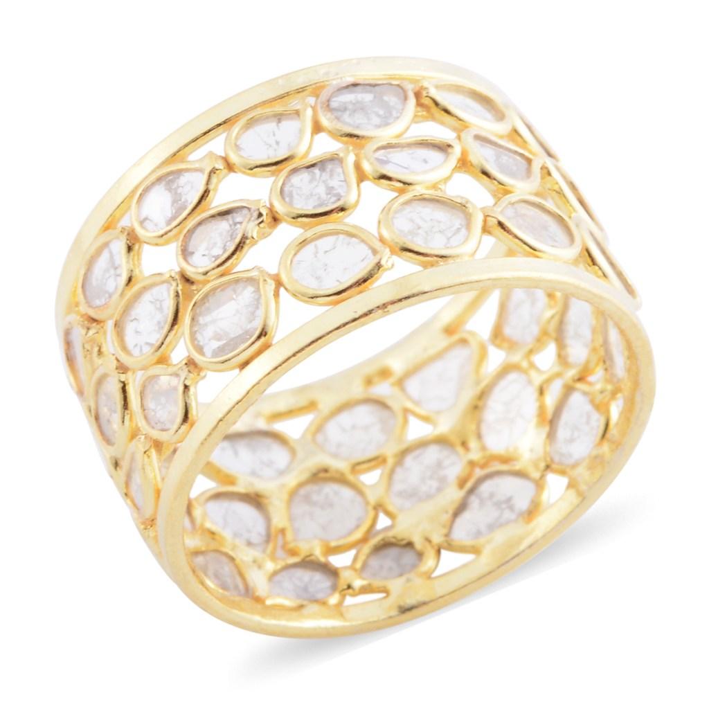 Polki diamond band ring on white background.