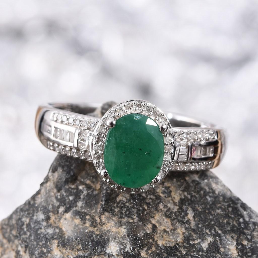 Socoto Emerald ring resting on granite rock.