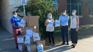 Shop LC donating face masks and hand sanitizer to Round Rock ISD.
