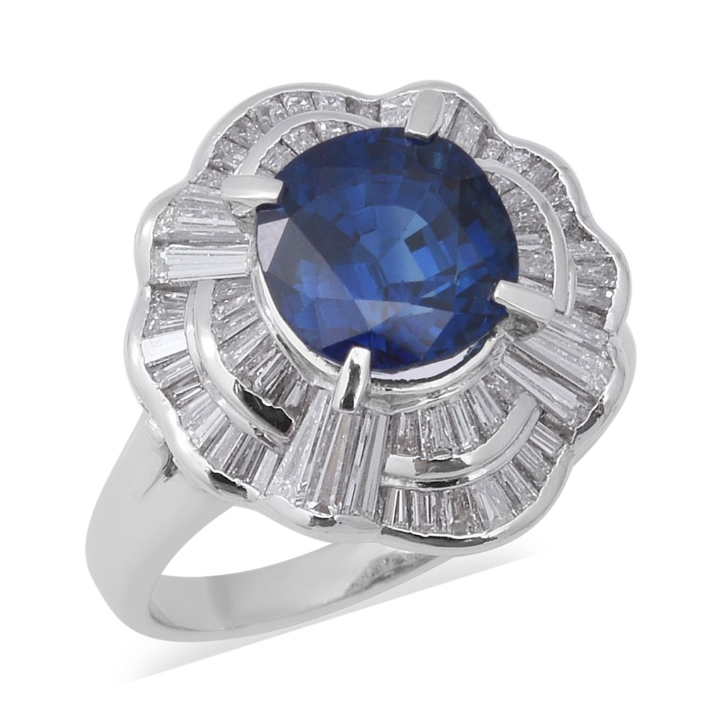 Vintage-style sapphire ring in halo setting.