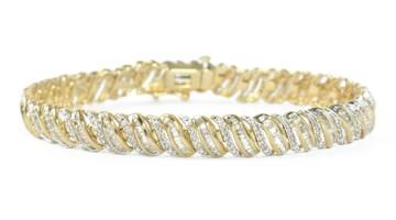 S-Link tennis bracelet in yellow gold.