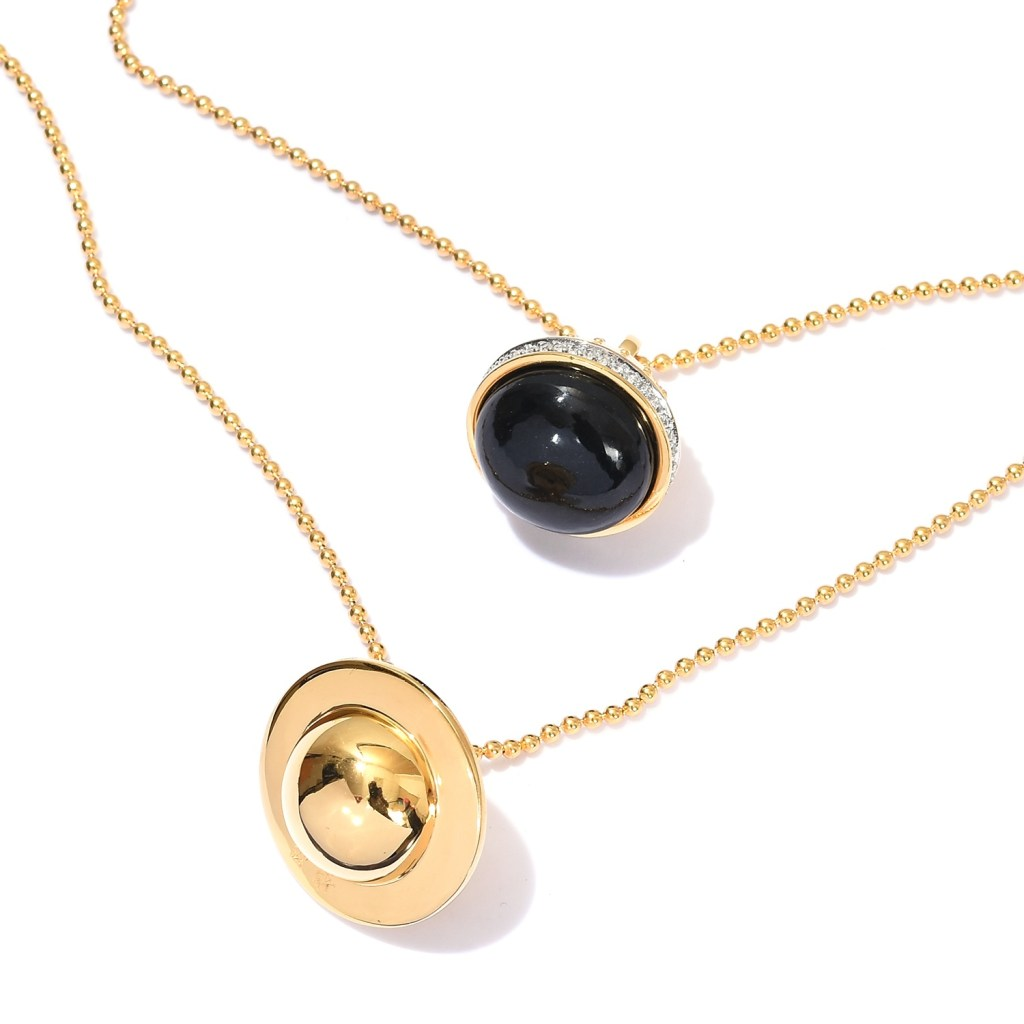 Gold necklace with dark stone.
