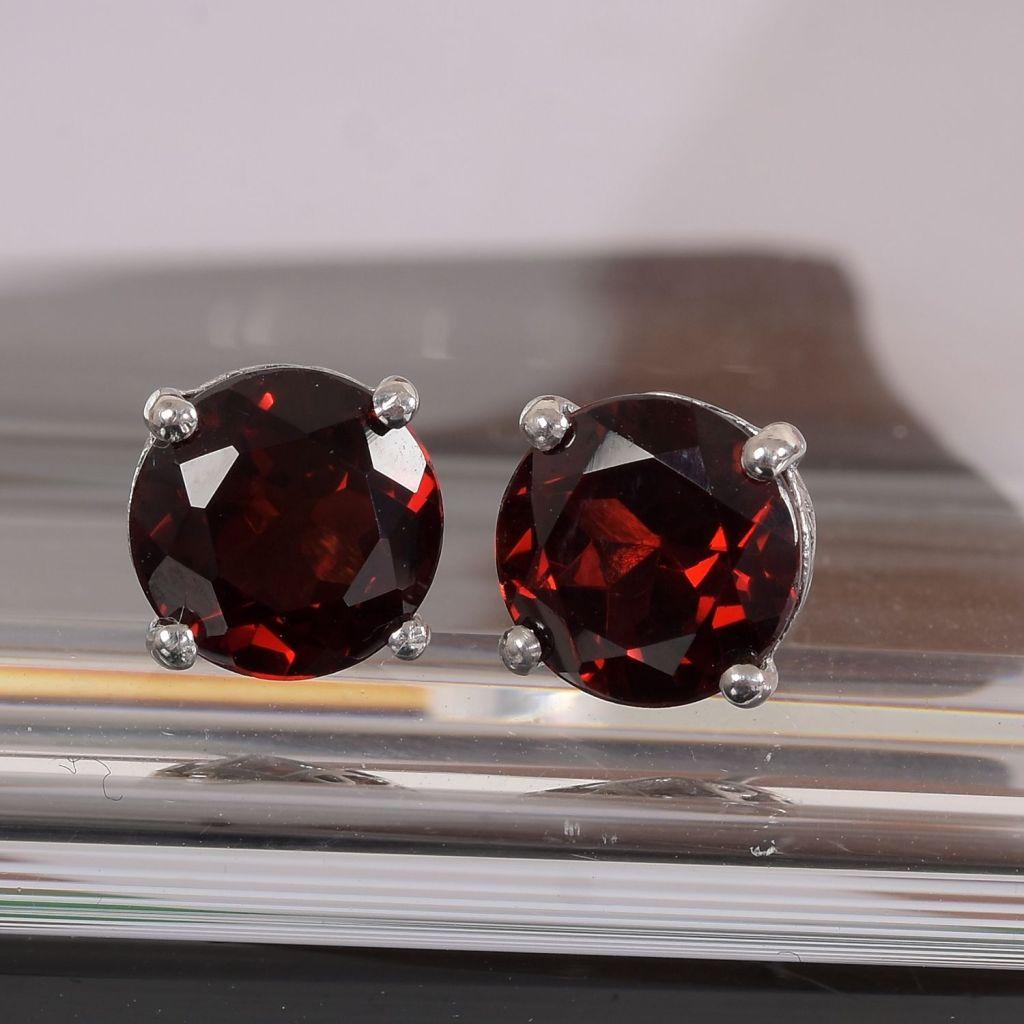 Garnet stud earrings in sterling silver.