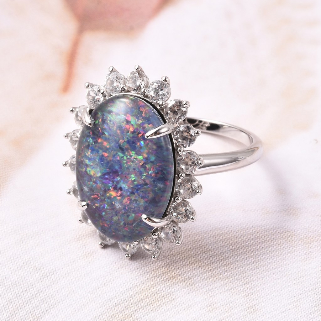 Boulder opal halo ring in sterling silver.
