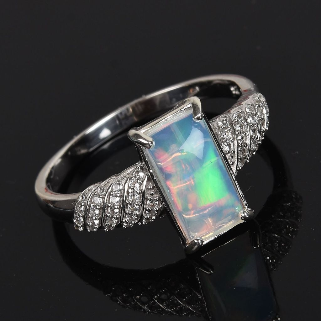 White opal ring in sterling silver.
