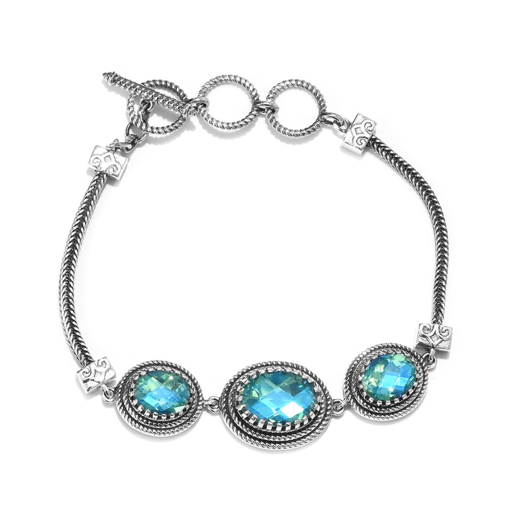 Sterling silver trilogy bracelet with peacock stone.