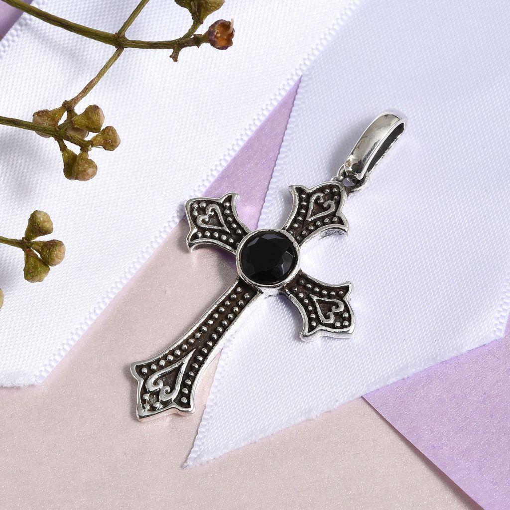 Black spinel cross pendant.