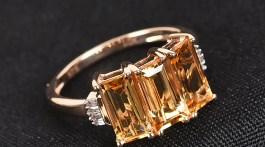 Golden three stone ring.