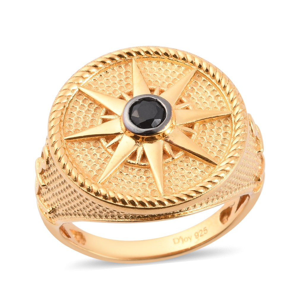 Intricate gold men's ring with black gemstone accent.