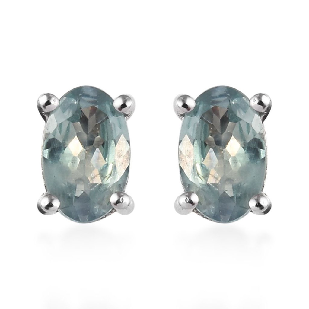 Alexandrite stud earrings showing bluish green color change.