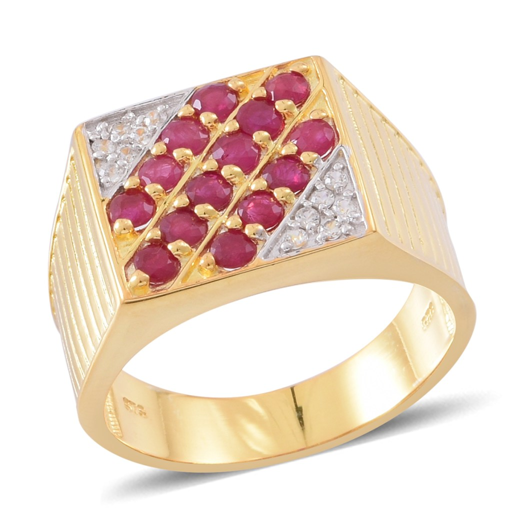 Gold ruby ring with zircon accents.