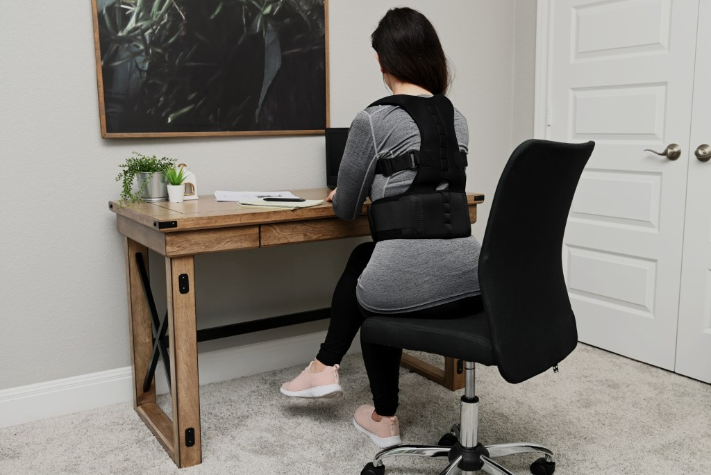 Woman wearing posture corrector.