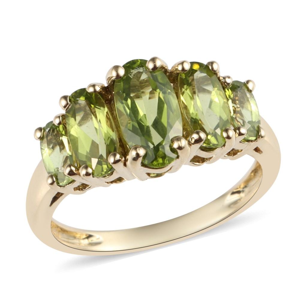 Peridot five stone ring in 10K yellow gold.