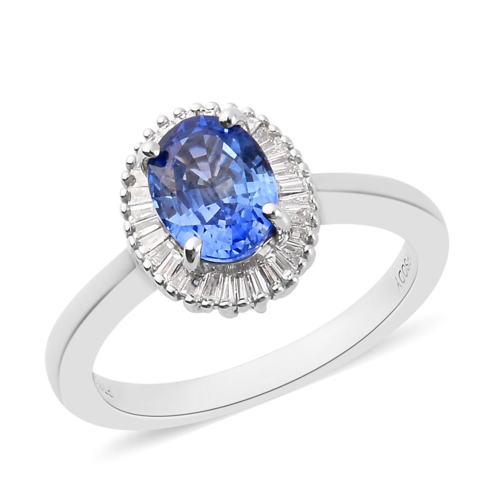 Blue sapphire halo ring in platinum.