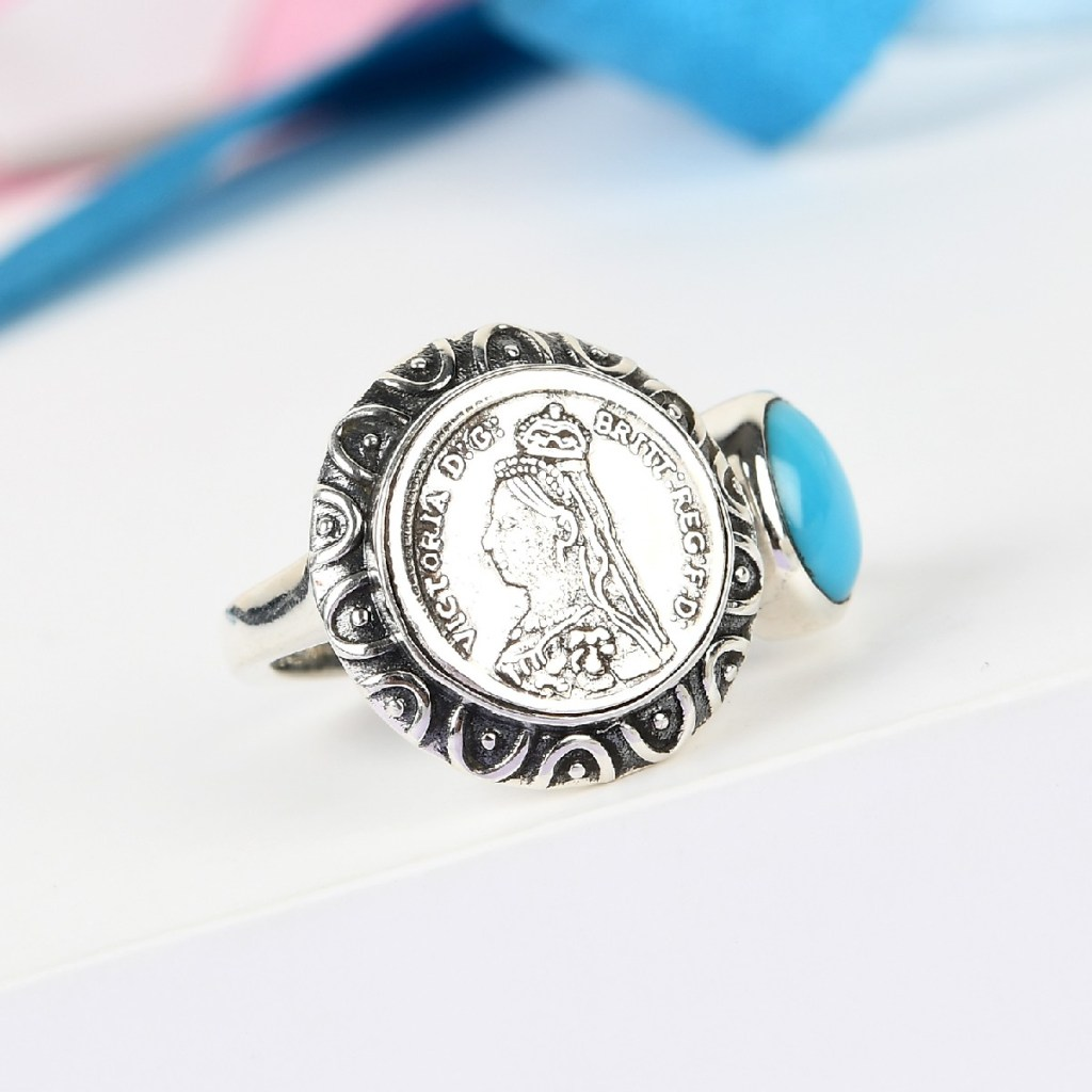 Sterling silver coin ring.