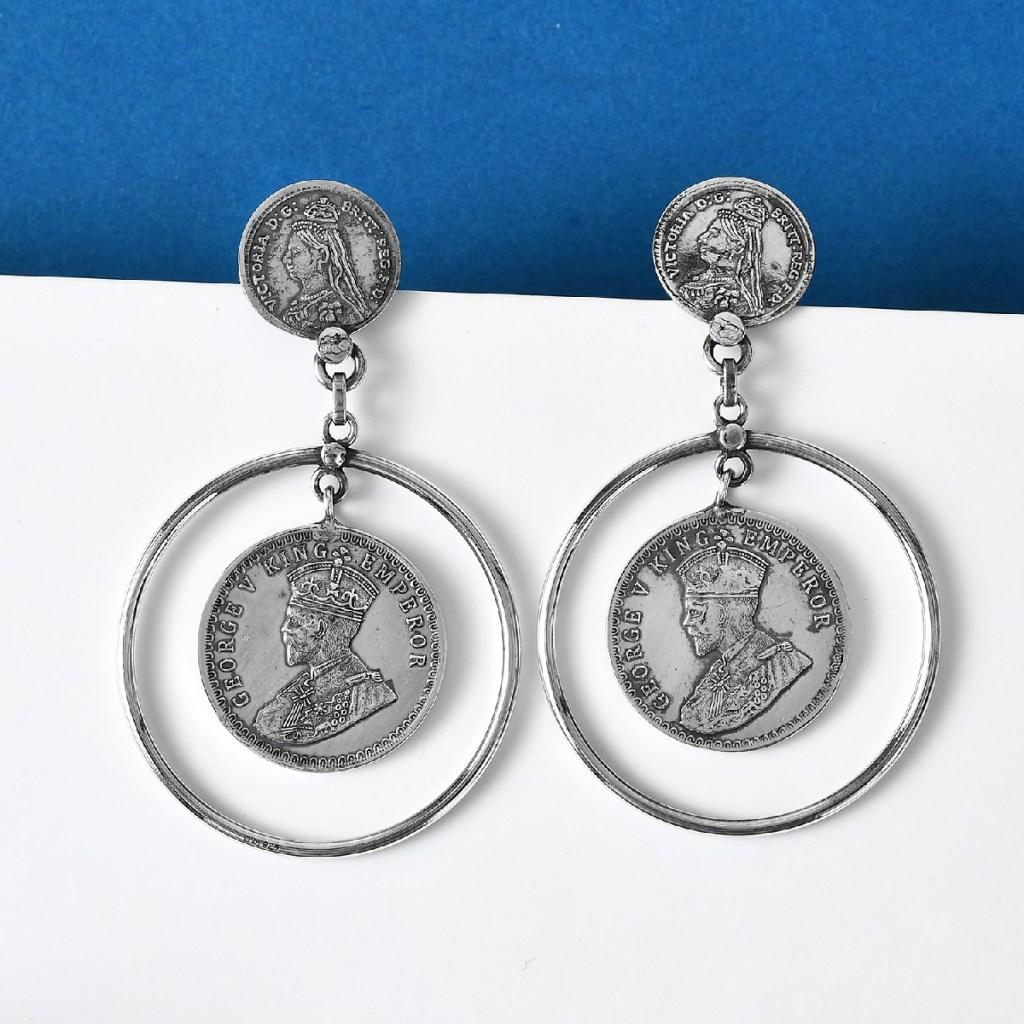 Sterling silver coin earrings.