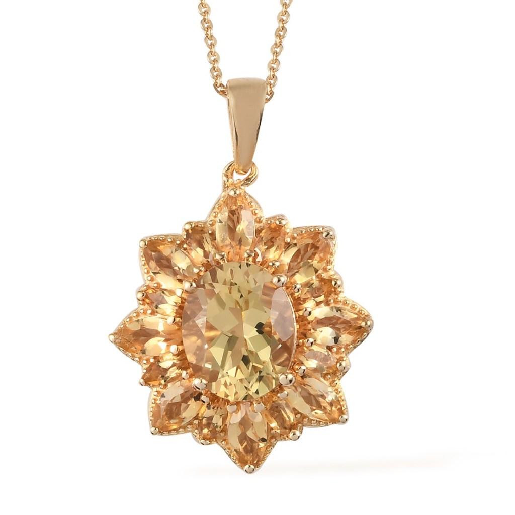 Gold sunburst pendant.