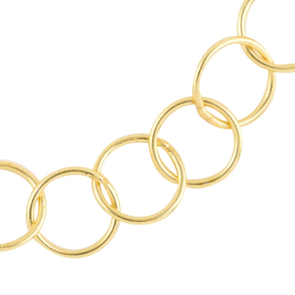 Gold tone unity necklace.