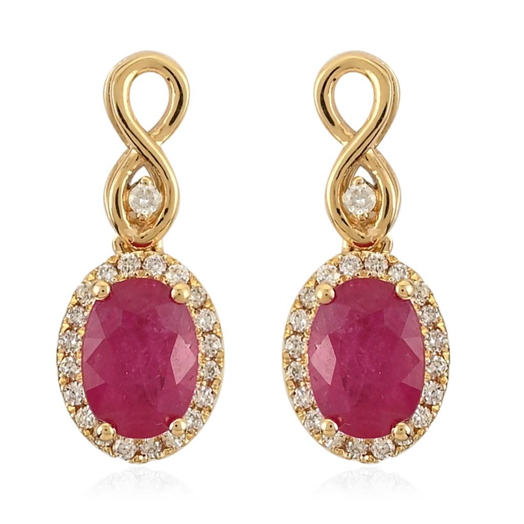 AAA ruby earrings in yellow gold.