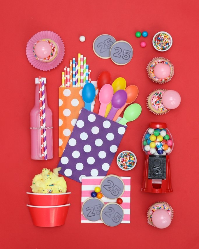 gumball style board with rainbow party supplies on red background - Bubble Gum Party Ideas - Valentine's Day Party Ideas
