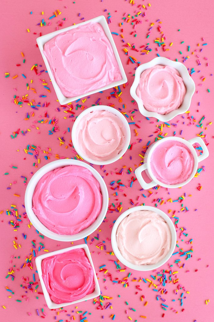 Overhead view of buttercream frosting in shades of pink