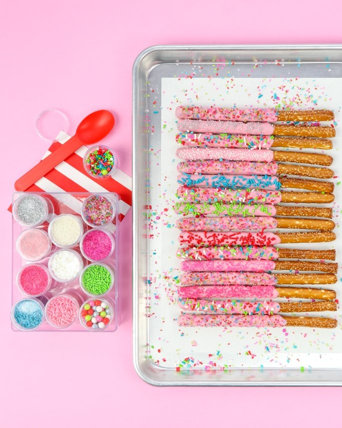 Sprinkle Dipped Christmas Chocolate Covered Pretzel Rods