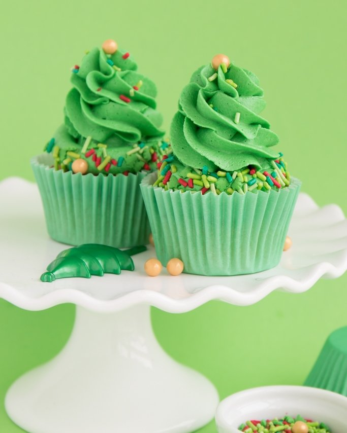 Christmas Tree Cupcakes on white cake plate and green background