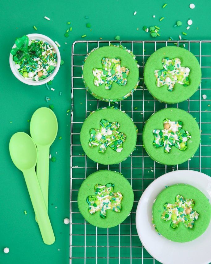Clover cut out sprinkle cookies on cooking rack